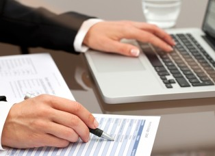 http://www.dreamstime.com/stock-image-female-hands-reviewing-documents-image27028201